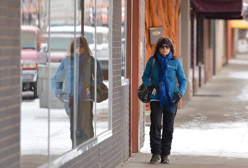 Justin Sheely | The Sheridan Press<br /> <br /> Teresa Araas walks down Main Street Wednesday, Jan. 31, 2018. Light snow overnight made slippery roads and sidewalks.