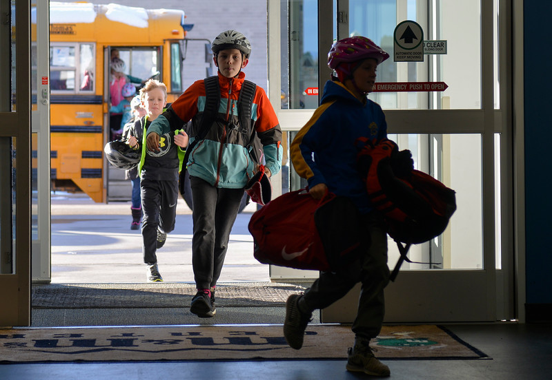 Justin Sheely | The Sheridan Press<br /> <br /> Fourth-grader Beck Haswell, center, runs into the building for open skate at Whitney Rink at the M&M's Center Wednesday, Jan. 31, 2018.