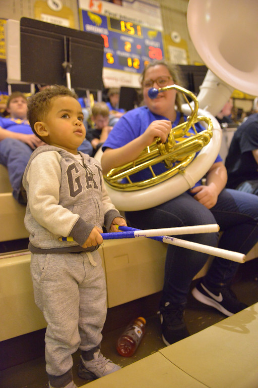 Justin Sheely   The Sheridan Press<br /> <br /> Two-year-old Drake Proctor plays with drum sticks as Sheridan sophomore Annie Diaz, right, looks on during the Broncs' game against Campbell County at Sheridan High School Thursday, Feb. 1, 2018.