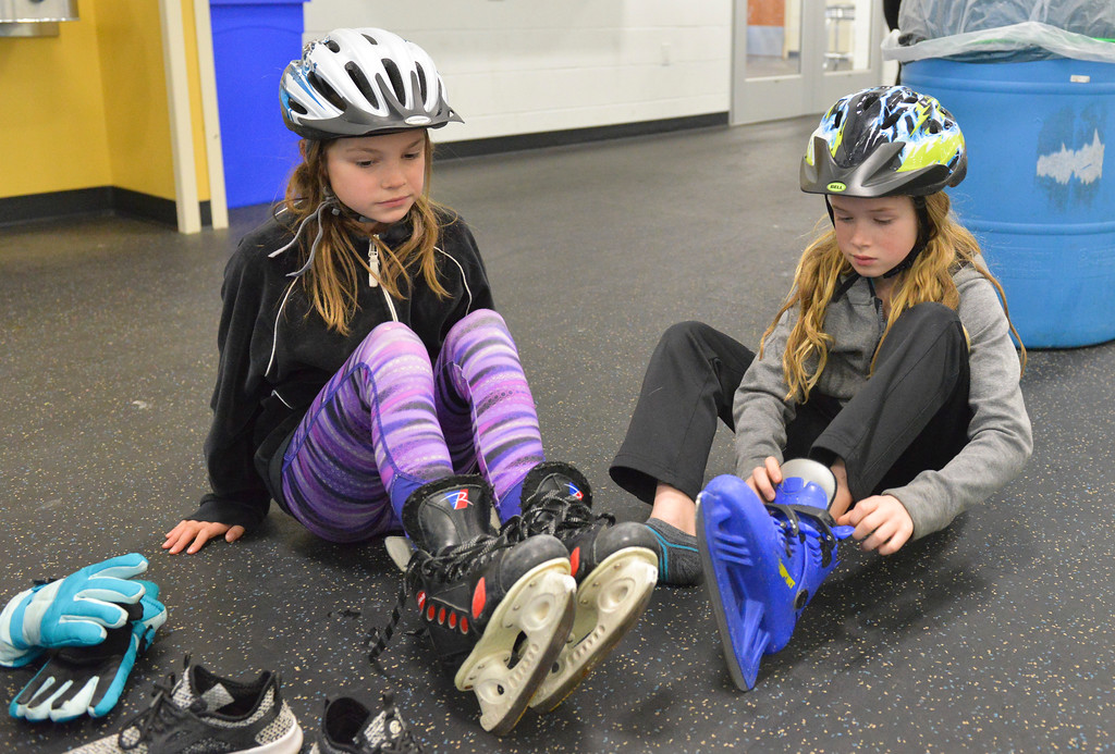 Justin Sheely   The Sheridan Press<br /> <br /> Third-graders Ruby Szewc, left, and Lexi Johnston put their skates on during open skate at Whitney Rink at the M&M's Center Wednesday, Jan. 31, 2018.