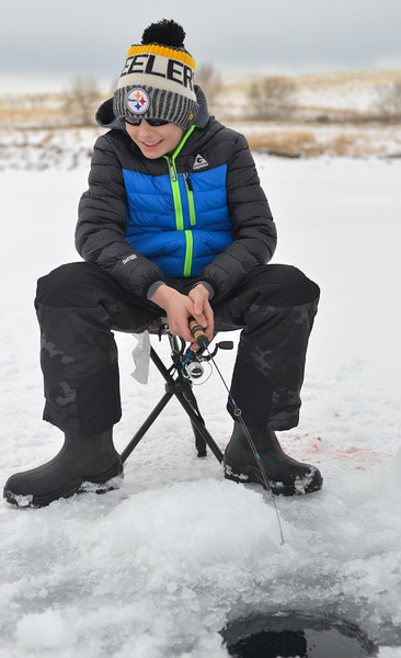 Justin Sheely | The Sheridan Press<br /> <br /> Twelve-year-old Cash McMeans waits at his ice hole during ice fishing at Lake De Smet Friday, Feb. 2, 2018.
