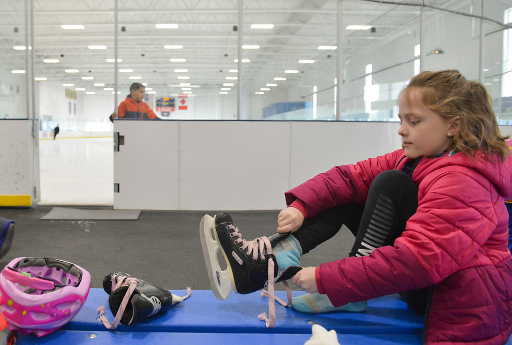 Justin Sheely   The Sheridan Press<br /> <br /> Second-grader Merritt Haswell puts on her skates during open skate at Whitney Rink at the M&M's Center Wednesday, Jan. 31, 2018.