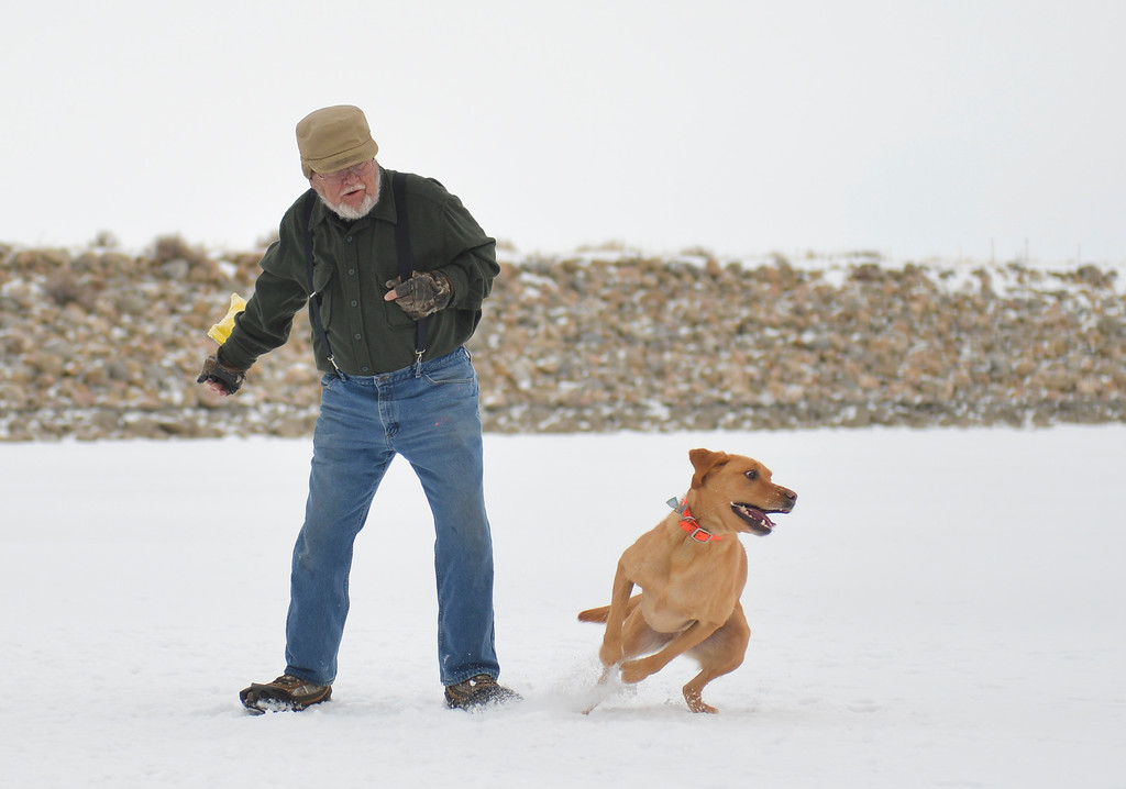 Justin Sheely   The Sheridan Press<br /> <br /> Larry Orrell passes time with his dog Wintson during ice fishing at Lake De Smet Friday, Feb. 2, 2018.