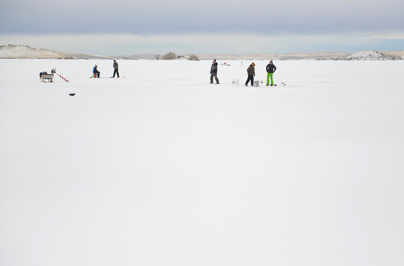 Justin Sheely | The Sheridan Press<br /> <br /> Children visit as they watch their lines during ice fishing at Lake De Smet Friday, Feb. 2, 2018.