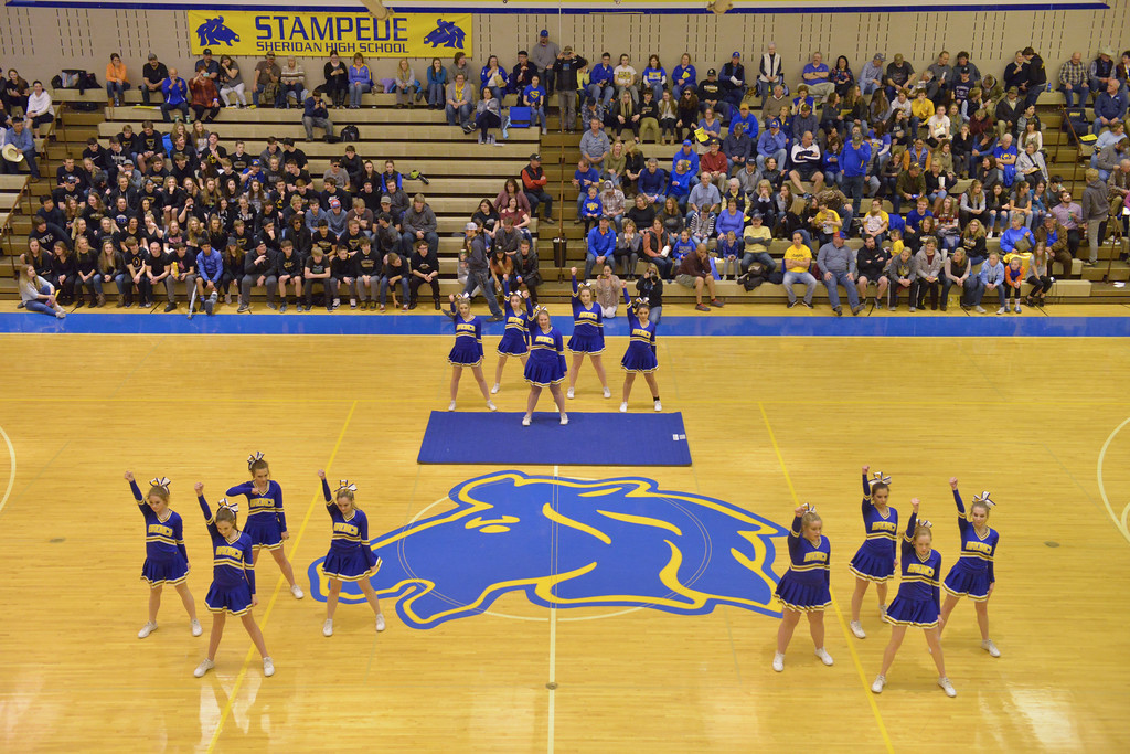 Justin Sheely   The Sheridan Press<br /> <br /> Sheridan Broncs cheer team does their program at halftime during the Broncs' game against Campbell County at Sheridan High School Thursday, Feb. 1, 2018.