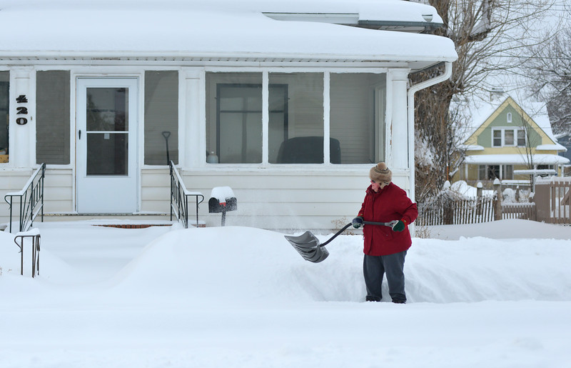 Justin Sheely | The Sheridan Press<br /> <br /> A resident shovels the sidewalk on Loucks Street in Sheridan Friday, Feb. 9, 2018. The city of Sheridan collected 8.3 inches of snow and 11.6 inches was reported northwest of Sheridan as of 10 a.m. Friday.