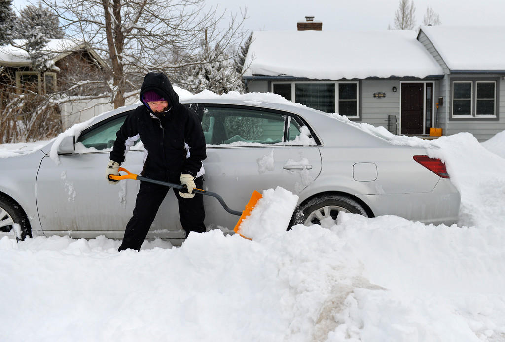 Justin Sheely | The Sheridan Press<br /> <br /> Beth Kelsey digs out her sedan from a residential street in Sheridan Friday, Feb. 9, 2018. The city of Sheridan collected 8.3 inches of snow and 11.6 inches was reported northwest of Sheridan as of 10 a.m. Friday.