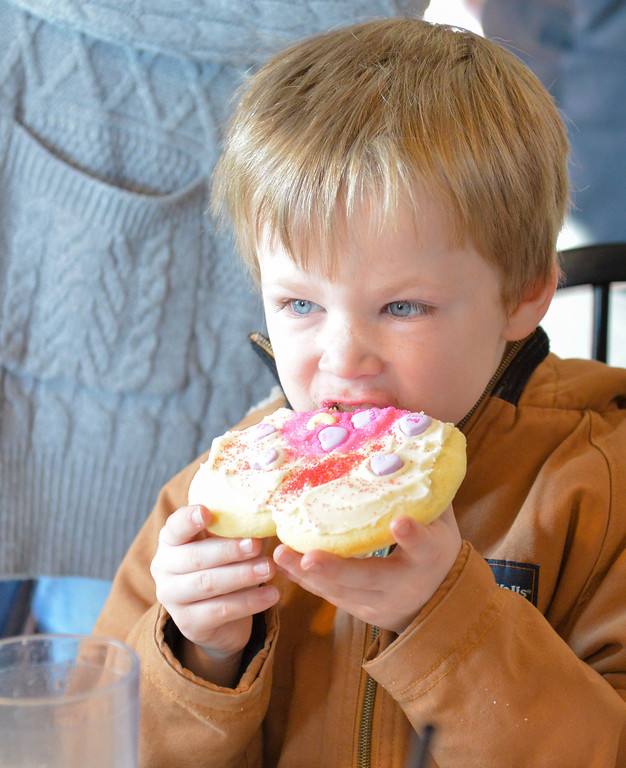 Justin Sheely | The Sheridan Press<br /> Six-year-old Jackson Post takes a bite out of his cookie during the 3rd-annual Valentine's Day cookie decorating event at Andi's Coffee House Saturday, Feb. 10, 2018.