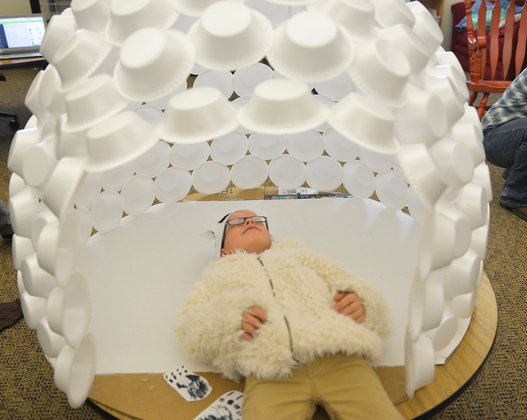 Justin Sheely | The Sheridan Press<br /> <br /> First-grade student Will Redinger, as a polar bear, hangs out inside a styrofoam igloo during the Animal Wax Museum event at Woodland Park Elementary School Friday, Feb. 9, 2018. First-grade students researched animals and gave a presentation on their findings through display boards, report books and costumes.