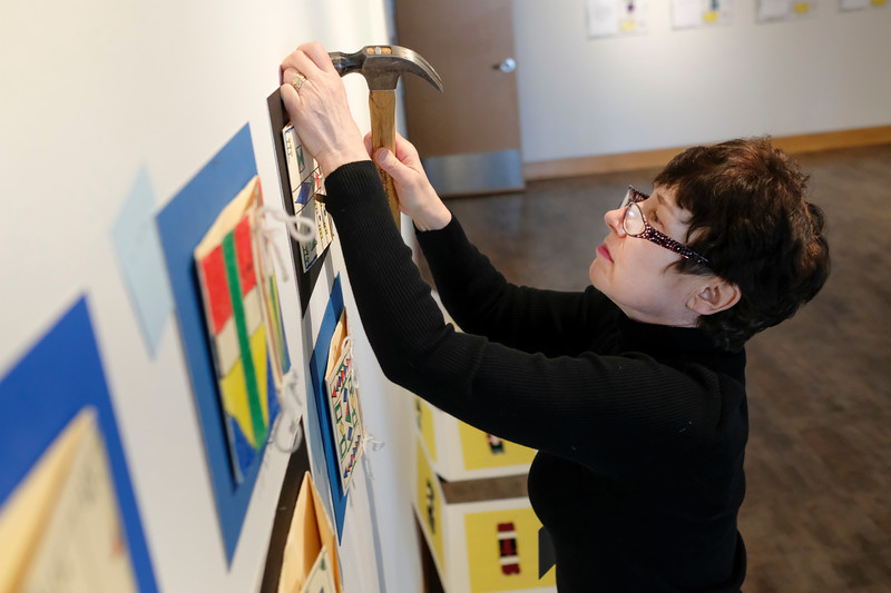 Justin Sheely | The Sheridan Press <br> Curator of exhibits and museum education Barbara McNab hangs fifth-grade student art work at the Brinton Museum Thursday, Feb. 8, 2018. The Brinton will host a reception for the All-Schools Fifth-Grade Student Art Show Sunday, Feb. 11, from 2 – 4 p.m.at the Brinton Museum on 239 Brinton Road, Big Horn.