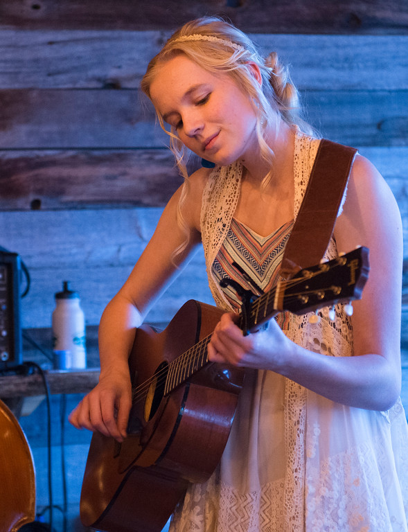 Justin Sheely | The Sheridan Press<br /> <br /> Fifteen-year-old Holly Qualm plays the guitar with the Buffalo, Wyoming, all-girl group Prairie Wildfire at Luminous Brewhouse Friday, Jan. 26, 2018. The teenage musicians are raising funds to record their first album.