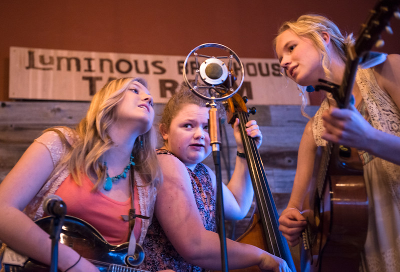 Justin Sheely | The Sheridan Press<br /> <br /> Prairie Wildfire players, from left, Sage Palser, Morgan Blaney and Holly Qualm perform at Luminous Brewhouse Friday, Jan. 26, 2018. The teenage musicians are raising funds to record their first album.