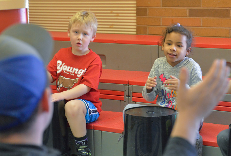 "Justin Sheely | The Sheridan Press<br /> Kindergarteners Rhys Guzik, left, and Treasure Coleman follow the instructor's lead as they make a beat during the ""Big Horn Friday Fun Day"" at the YMCA Friday, Jan 26, 2018. The YMCA hosts fun activates for Big Horn Elementary students on Fridays in collaboration with Sheridan County School District 1."