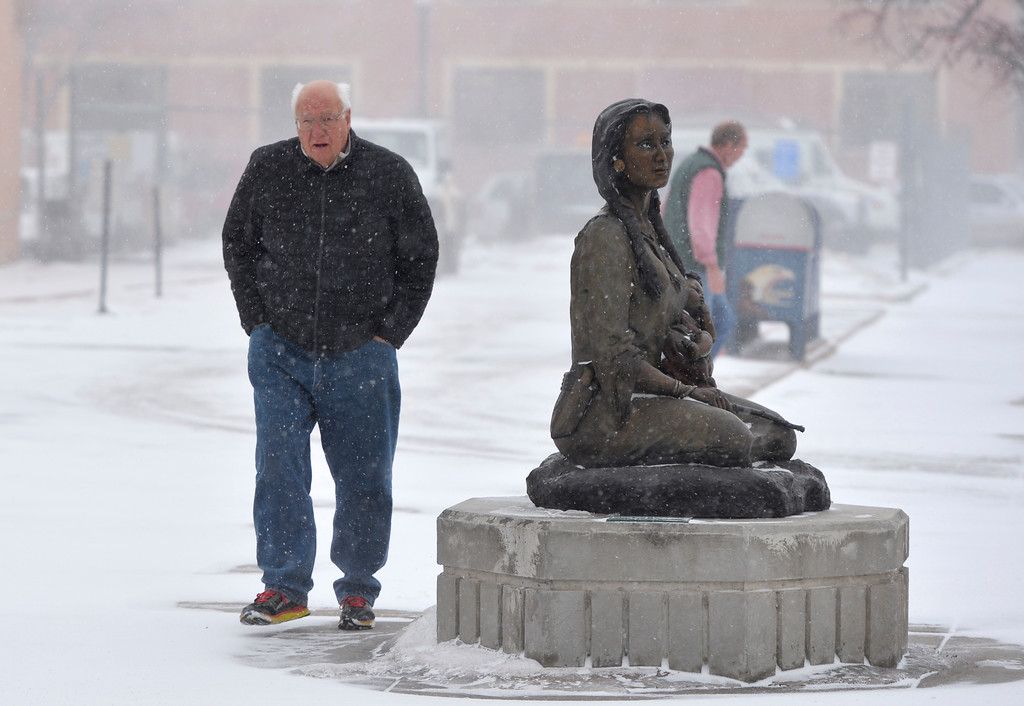 Justin Sheely | The Sheridan Press<br /> Brian Morgan walks past the post office as snow blows through Sheridan Wednesday, Jan. 10, 2018. The National Weather Service issued a winter weather advisory for the region, expecting 3 to 5 inches of snow.