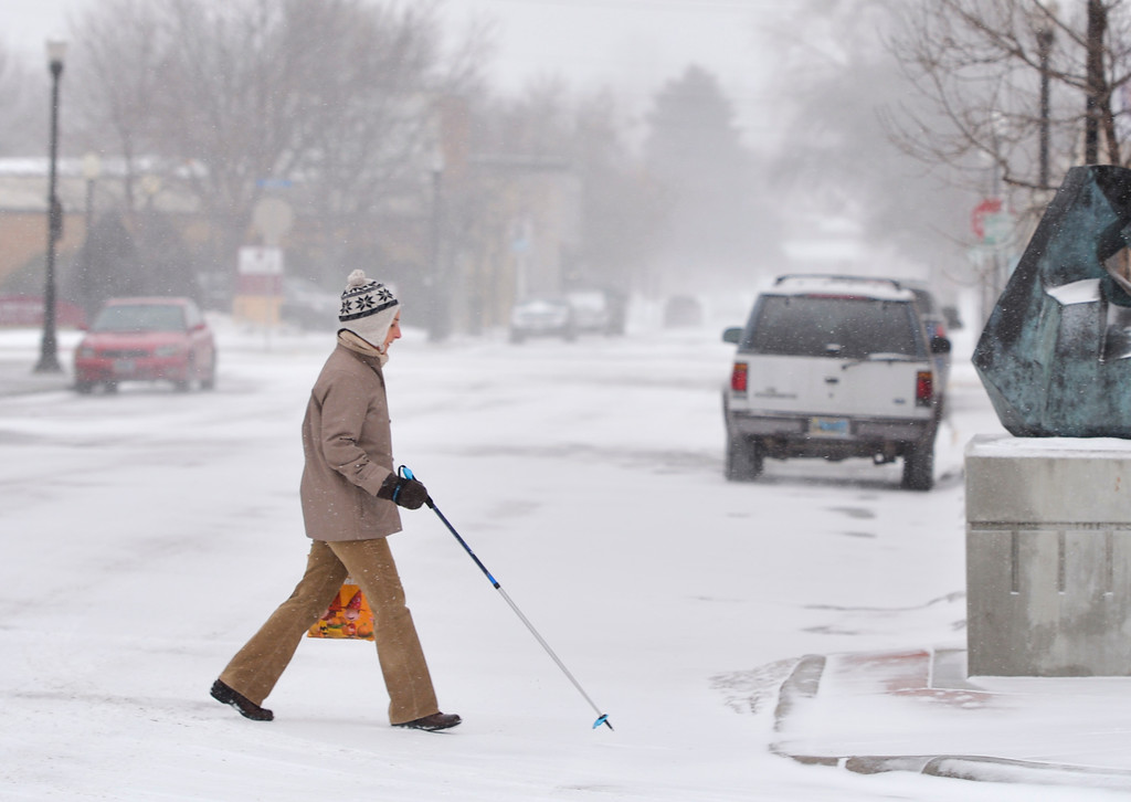 Justin Sheely | The Sheridan Press<br /> A woman crosses a snowy street in downtown Sheridan Wednesday, Jan. 10, 2018. The National Weather Service issued a winter weather advisory for the region, expecting 3 to 5 inches of snow.