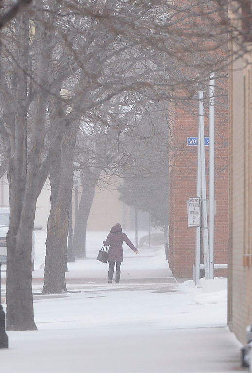Justin Sheely | The Sheridan Press<br /> A person walks along Gould Street as snow blows through Sheridan Wednesday, Jan. 10, 2018. The National Weather Service issued a winter weather advisory for the region, expecting 3 to 5 inches of snow.