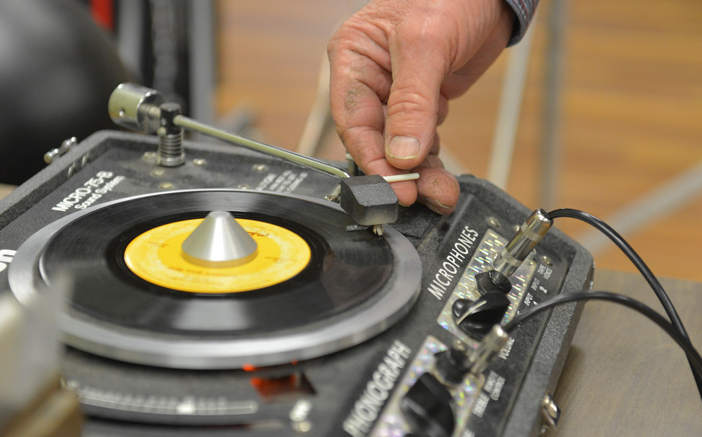 Justin Sheely | The Sheridan Press<br /> Dance caller George Baker puts a vinyl on the turn table during the weekly Jeans and Queens square dance night at the Hub on Smith Saturday, Jan. 13, 2018. The square dance club meets every Tuesday evening at the Hub on Smith for lessons, which are open and free for first time dancers.