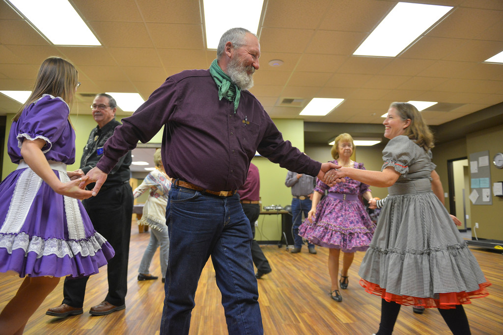 Justin Sheely | The Sheridan Press<br /> Ed Grywusiewicz, center, and Kate Yapunich, right, dance during the weekly Jeans and Queens square dance night at the Hub on Smith Saturday, Jan. 13, 2018. The square dance club meets every Tuesday evening at the Hub on Smith for lessons, which are open and free for first time dancers.