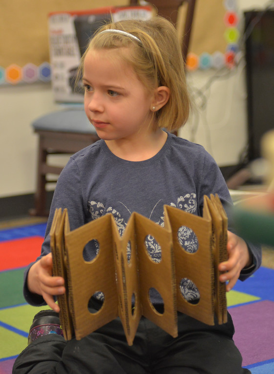 "Justin Sheely | The Sheridan Press<br /> First-grader Myka Perry plays with a cardboard instrument during an after school program ""Making Music"" at Coffeen Elementary School Thursday, Jan. 11, 2018. Sheridan County School District 2 offers STEM and art based activities for students registered with their after school programs."