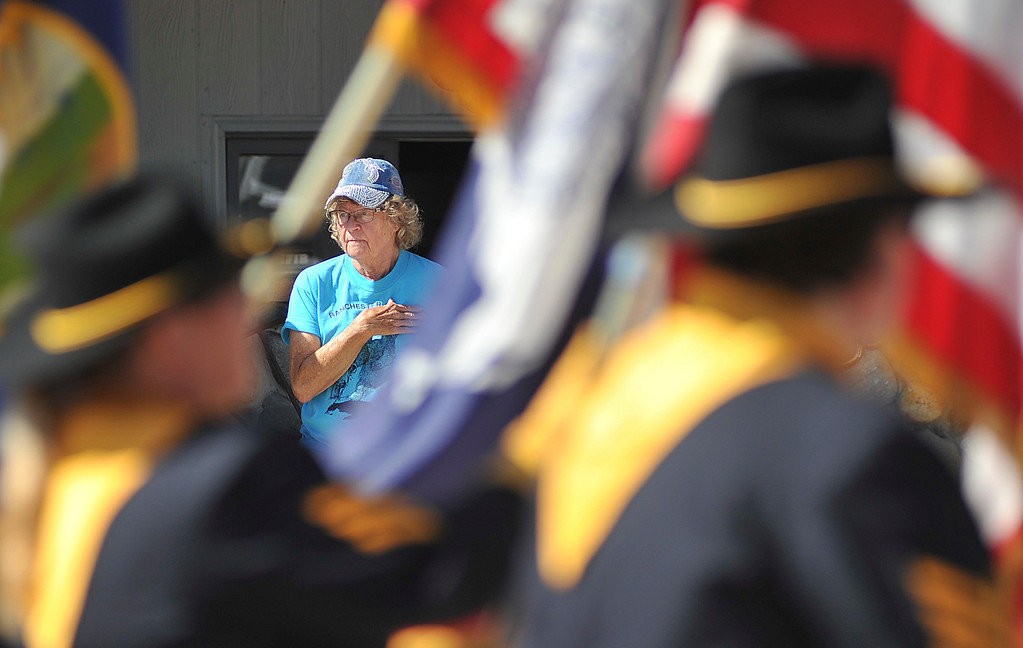 Justin Sheely | The Sheridan Press<br /> Phyllis Schenderline stands as the national flag is carried by the American Legion during the second annual Hay Daze in Ranchester Saturday, June 9, 2018.