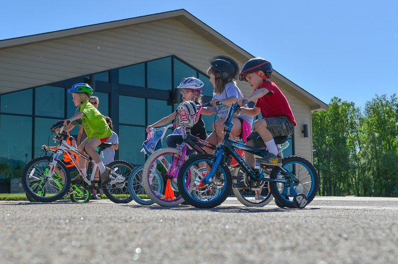 Justin Sheely | The Sheridan Press<br /> Children start their laps around the church building during the Make Room Bike-A-Thon at First Baptist Church Saturday, June 2, 2018. The event supported the Summer of Hope program, which brings orphan children from around the world to host families in the United State for the summer.