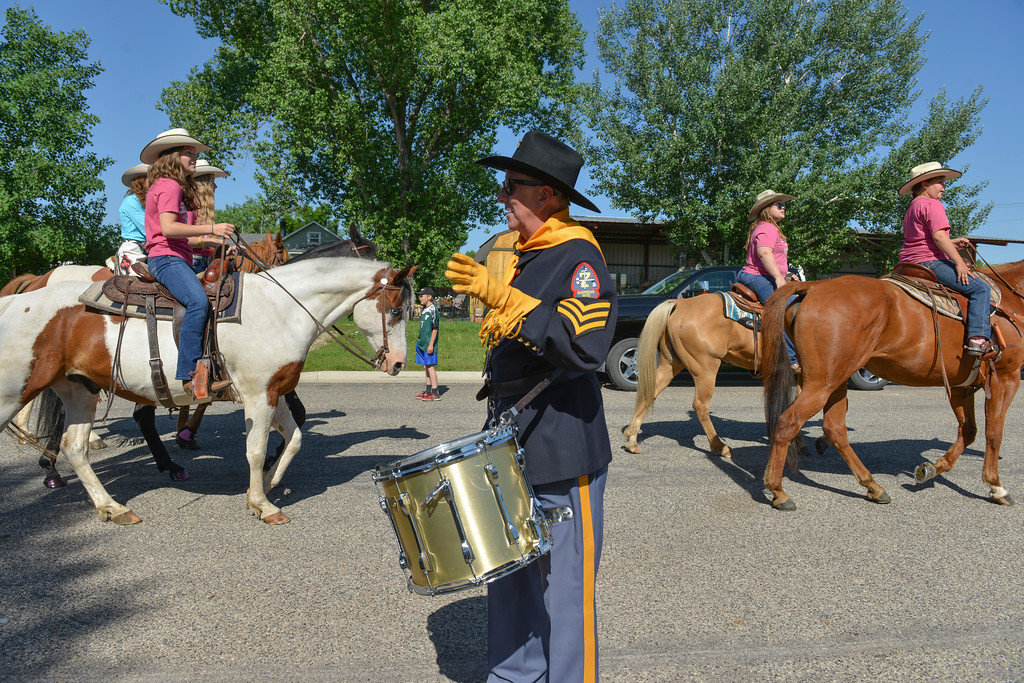 Justin Sheely | The Sheridan Press<br /> American Legion Post 7 Drum and Bugle Corps member Thomas Laya waves as horse riders go by to the staging area during the second annual Hay Daze in Ranchester Saturday, June 9, 2018.