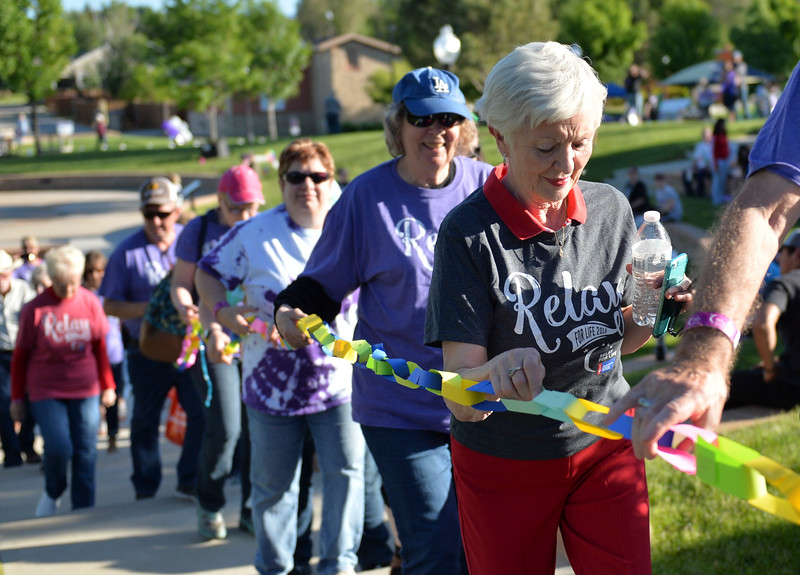 Justin Sheely | The Sheridan Press<br /> Anita Schamber holds a section of the survivors chain during the annual Relay for Life event at Whitney Commons Park Saturday, June 2, 2018. The event supports the American Cancer Society.