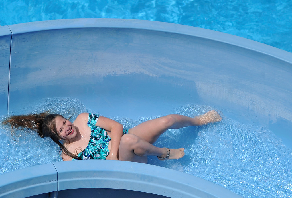 Justin Sheely | The Sheridan Press<br /> Twelve-year-old Kiaya Allen goes down the slide at Kendrick Pool Thursday, June 7, 2018. Kendrick Pool open swim is daily from 1 p.m. to 7 p.m. Children 2 years and under are free.