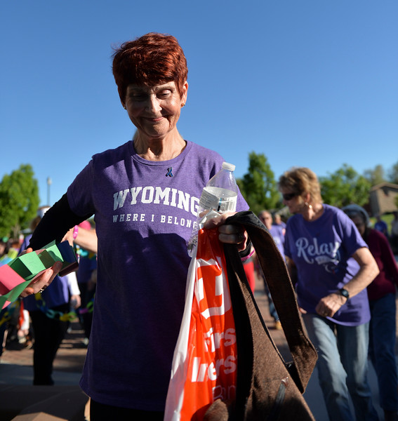 Justin Sheely | The Sheridan Press<br /> 10-year cancer survivor Judy Hayworth participates in the survivors walk during the annual Relay for Life event at Whitney Commons Park Saturday, June 2, 2018. The event supports the American Cancer Society.