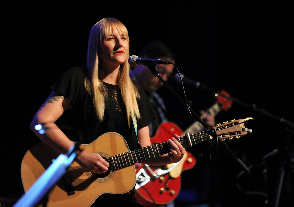 "Justin Sheely | The Sheridan Press<br /> Sarah Sample performs at the Whitney Center for the Arts Concert Hall Saturday, June 9, 2018. The award-winning songwriter is promoting her latest work Redwing, which is described as a spiritual ""breakup album"" she composed after she left her family's religion."
