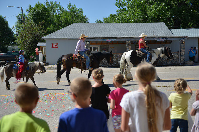 Justin Sheely | The Sheridan Press<br /> Children watch horse riders go by during the second annual Hay Daze in Ranchester Saturday, June 9, 2018.