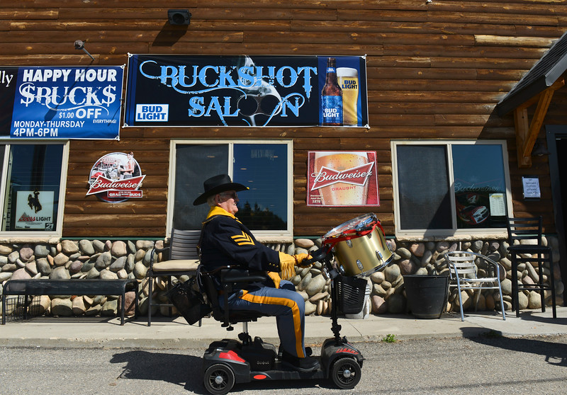 Justin Sheely | The Sheridan Press<br /> Drum and Bugle Corps drummer Jerry Barker rolls on by the Buckshot Saloon during the second annual Hay Daze in Ranchester Saturday, June 9, 2018.
