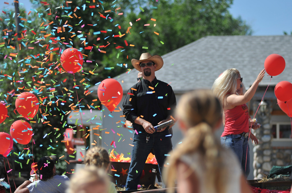 Justin Sheely | The Sheridan Press<br /> Confetti flies as parade float go by during the second annual Hay Daze in Ranchester Saturday, June 9, 2018.