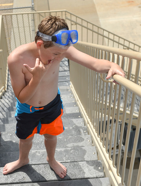 Justin Sheely | The Sheridan Press<br /> Ten-year-old Aiden Long waits on the stairs of the pool slide at Kendrick Pool Thursday, June 7, 2018. Kendrick Pool open swim is daily from 1 p.m. to 7 p.m. Children 2 years and under are free.