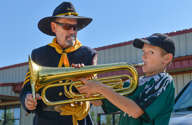 Justin Sheely | The Sheridan Press<br /> American Legion Post 7 Drum and Bugle Corps member Conrad Namtvedt gives his bass horn to Ayden Gay, 11, to try during the second annual Hay Daze in Ranchester Saturday, June 9, 2018.