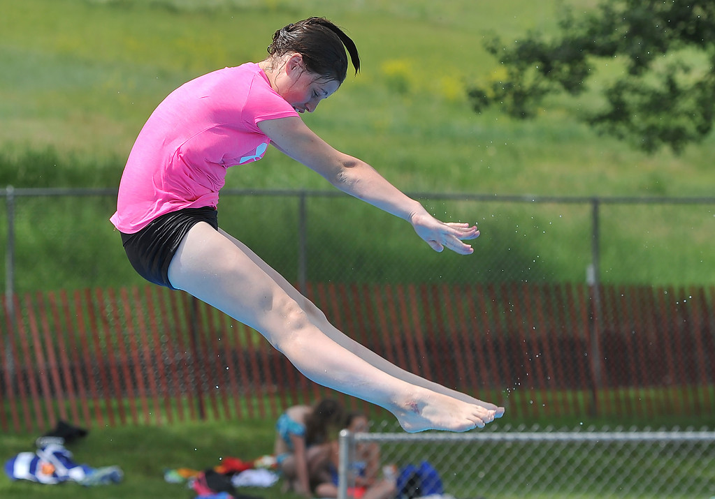 Justin Sheely   The Sheridan Press<br /> Eleven-year-old Maliyah Schimka launches off the diving board at Kendrick Pool Thursday, June 7, 2018. Kendrick Pool open swim is daily from 1 p.m. to 7 p.m. Children 2 years and under are free.