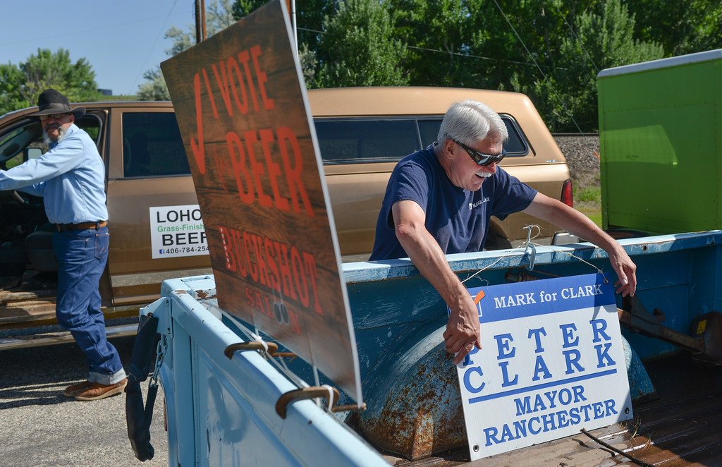 Justin Sheely | The Sheridan Press<br /> Ranchester Mayor Peter Clark hangs his campaign signs on his truck during the second annual Hay Daze in Ranchester Saturday, June 9, 2018.