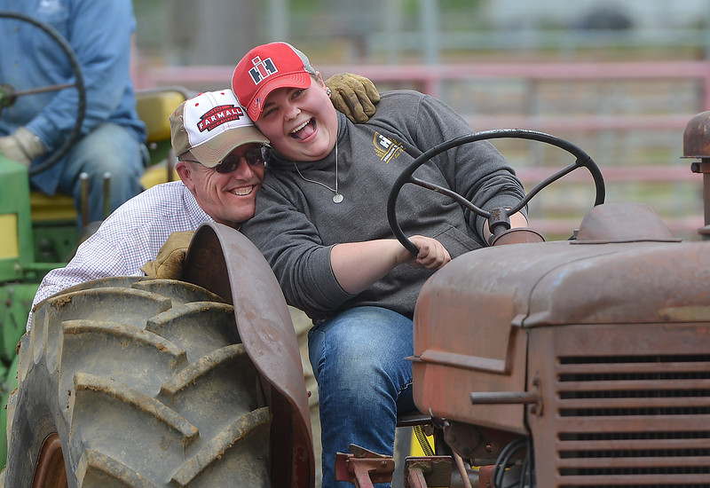 Justin Sheely | The Sheridan Press<br /> Dean Roberts greets Sarah Bacon as she gets ready to compete with her 1957 Farmall W9 tractor during the antique tractor pull at the Sheridan County Fairgrounds Saturday, June 16, 2018. 28 Antique tractor owners from the region took the challenge of the tractor pull, which involved pulling a sled with a nearly 10,000 lbs load across a dirt track 220 feet for a full pull.