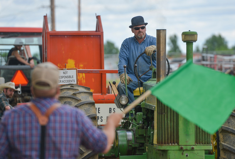 Justin Sheely | The Sheridan Press<br /> Brad Rozema of Buffalo gets ready to pull during the antique tractor pull at the Sheridan County Fairgrounds Saturday, June 16, 2018. 28 Antique tractor owners from the region took the challenge of the tractor pull, which involved pulling a sled with a nearly 10,000 lbs load across a dirt track 220 feet for a full pull.