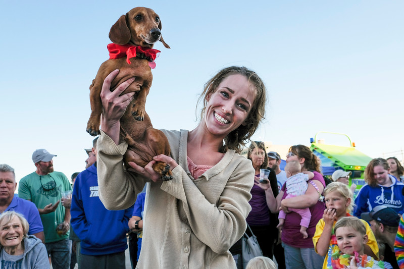 Justin Sheely | The Sheridan Press<br /> Casey Van Haele holds her winning dog Oscar during the annual Wiener Dog Race at Black Tooth Brewing Company Tuesday, June 12, 2018. The event was hosted for the sixth year by Muddy Paw Prints Pet Supplies.