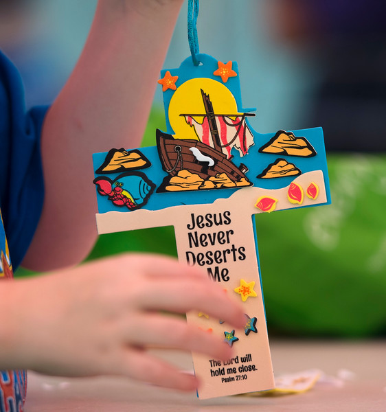 Justin Sheely | The Sheridan Press<br /> Children work on a craft activity during the Counting on God (VBS) camp at the YMCA Thursday, June 14, 2018.