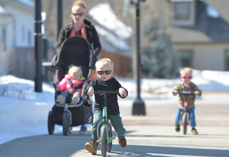 Justin Sheely  | The Sheridan Press<br /> Three-year-old Grayson Lee pushes ahead of his mother, Jodi Lee, and siblings at Whitney Commons Park Tuesday, March 13, 2018. Wednesday will be sunning with a high of 53 degrees, chances of rain and snow are expected Thursday and Friday.