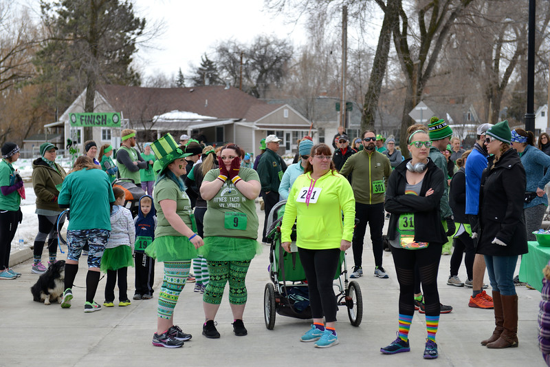 "Justin Sheely | The Sheridan Press<br /> Race participants visit at the registration area during the Sheridan Jaycees' annual ""Run 'Till your Green"" fun run/walk at Kendrick Park Saturday, March 17, 2017."