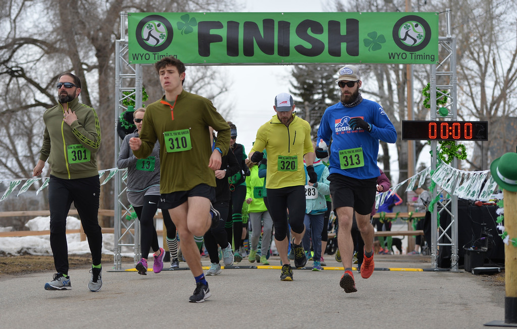 "Justin Sheely | The Sheridan Press<br /> Runners start the race during the Sheridan Jaycees' annual ""Run 'Till your Green"" fun run/walk at Kendrick Park Saturday, March 17, 2017."