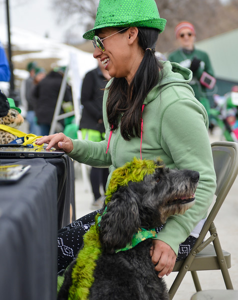 "Justin Sheely | The Sheridan Press<br /> Sierra Cahl registers for the race with her dog Tucker during the Sheridan Jaycees' annual ""Run 'Till your Green"" fun run/walk at Kendrick Park Saturday, March 17, 2017."