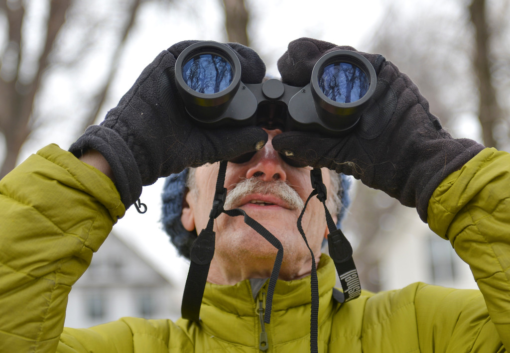 Justin Sheely | The Sheridan Press<br /> Story resident Gary Senier scans a nearby tree during the Bighorn Audubon Society's monthly Birding at the Brinton event in Big Horn Saturday, March 17, 2017. The Sheridan area sees migratory birds in March, notably, the sandhill crane.