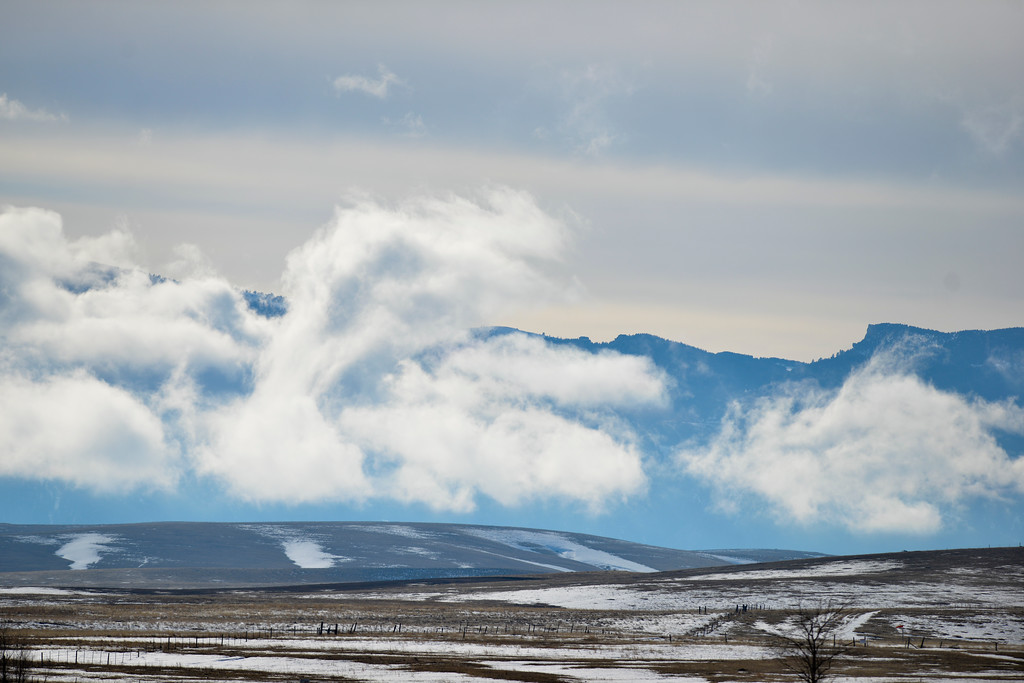 Justin Sheely | The Sheridan Press<br /> Clouds break up in front of the Bighorn Mountains late Friday, March 16, 2018.