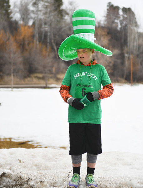 "Justin Sheely | The Sheridan Press<br /> Ten-year-old Drew Schneider waits for the race during the Sheridan Jaycees' annual ""Run 'Till your Green"" fun run/walk at Kendrick Park Saturday, March 17, 2017."
