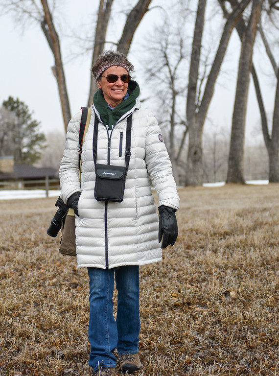 Justin Sheely | The Sheridan Press<br /> Joanne Puckett walks with her camera and binoculars during the Bighorn Audubon Society's monthly Birding at the Brinton event in Big Horn Saturday, March 17, 2017. The Sheridan area sees migratory birds in March, notably, the sandhill crane.