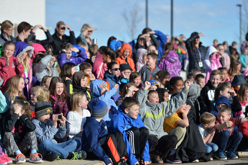 Justin Sheely | The Sheridan Press<br /> Students cheer on as teachers are hosed by firefighters at Woodland Park Elementary School Tuesday, March 20, 2018. Several Woodland Park teachers were sprayed down by a fire hose in celebration of their classrooms raising $80 in a penny drive for the Wyoming Special Olympics.